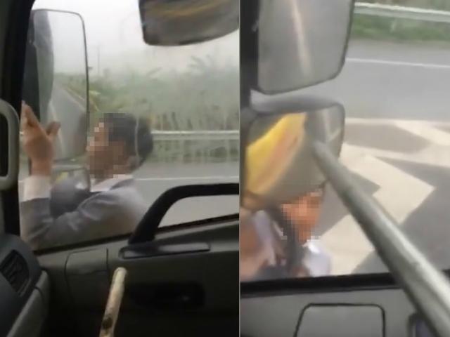 Thót tim cảnh người đàn ông chặn đầu, đu gương xe tải trên cao tốc