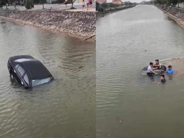 Ô tô mất lái rơi xuống sông, người dân hợp sức đập kính giải cứu tài xế