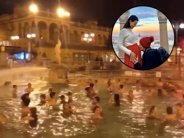 Đang mang thai, Hoàng Oanh vẫn tắm hồ nước nóng ngoài trời 1 độ C với chồng Tây