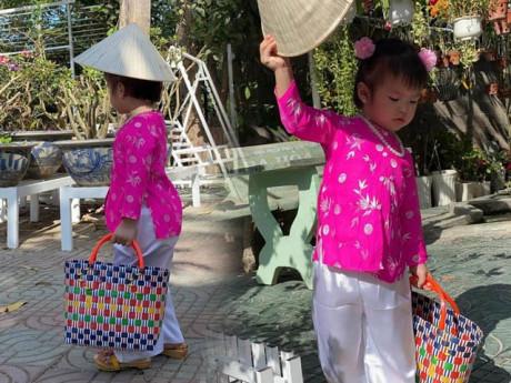 Con gái Lê Phương diện áo bà ba, xách làn đi chợ, đáng yêu và sành điệu không thua mẹ