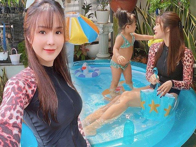 Đi chơi diện bikini bốc lửa chứ về nhà với con là Diệp Lâm Anh chọn áo tắm kín bưng