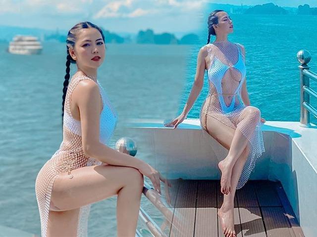 Đụng bikini khoét hông cao chót vót với Ngọc Trinh, gái xinh dậy sóng với hình xăm ở vòng ba