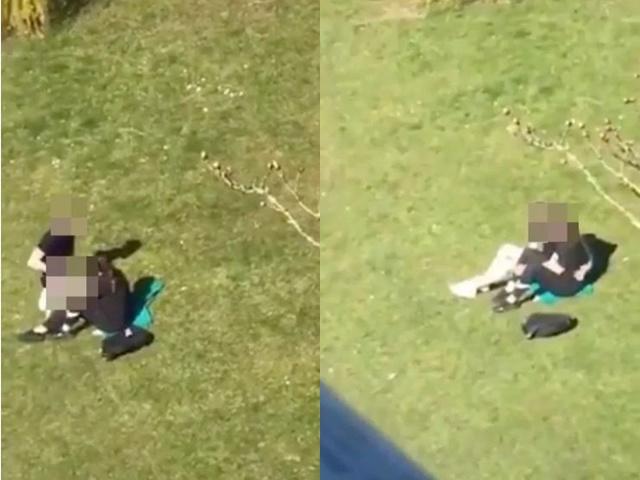 Cặp đôi mây mưa ngay bãi cỏ khu chung cư, bị bắt quả tang vẫn không chịu rời đi