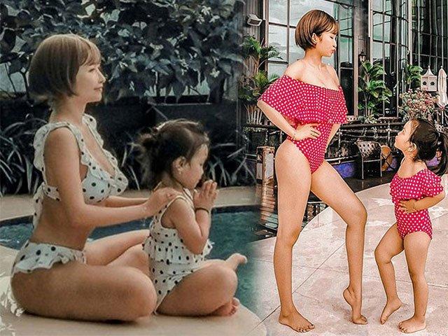 Vợ đại gia Minh Nhựa khoe dáng khi diện bikini đôi với con gái cưng