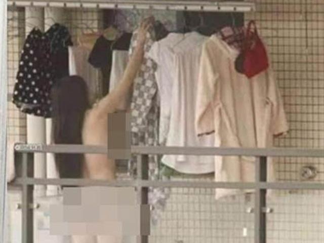 Thiếu nữ khỏa thân ra ban công phòng trọ phơi đồ khiến hàng xóm đối diện sốc nặng