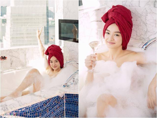 Hot girl ngực khủng Kaity Nguyễn gợi cảm trong cảnh tắm bồn trên đỉnh thành phố